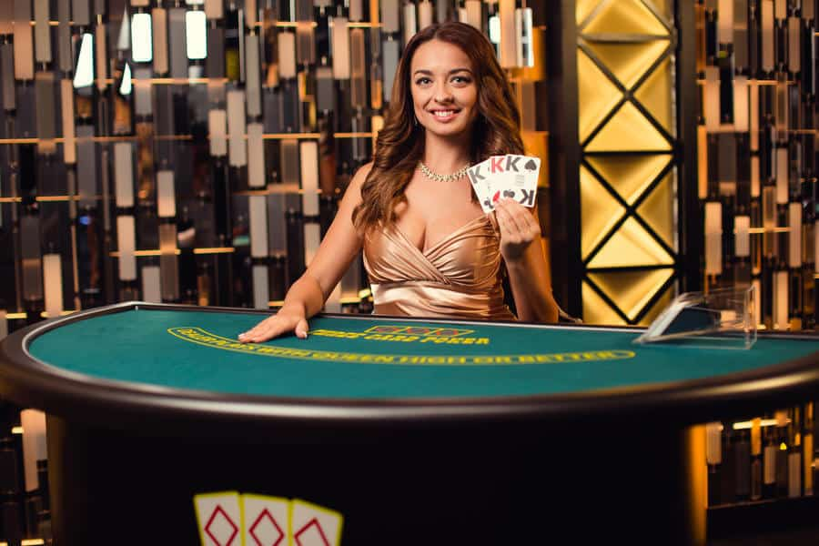 Live dealer holds up teen patti cards